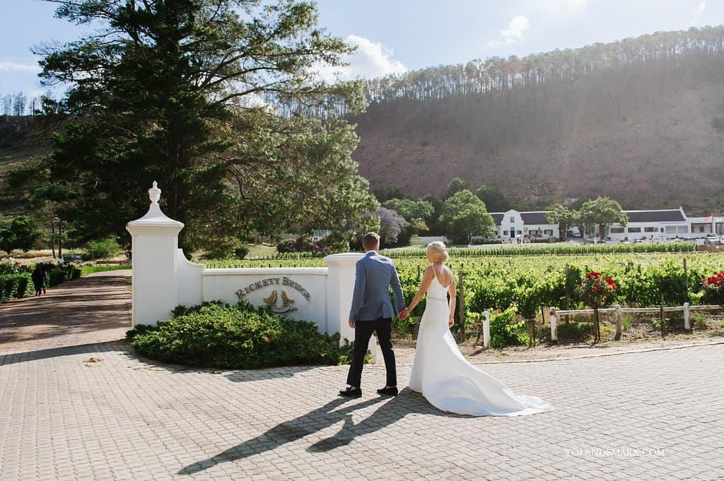 Wedding-couple-enter-the-gorgeous-rickety-bridge-estate-001